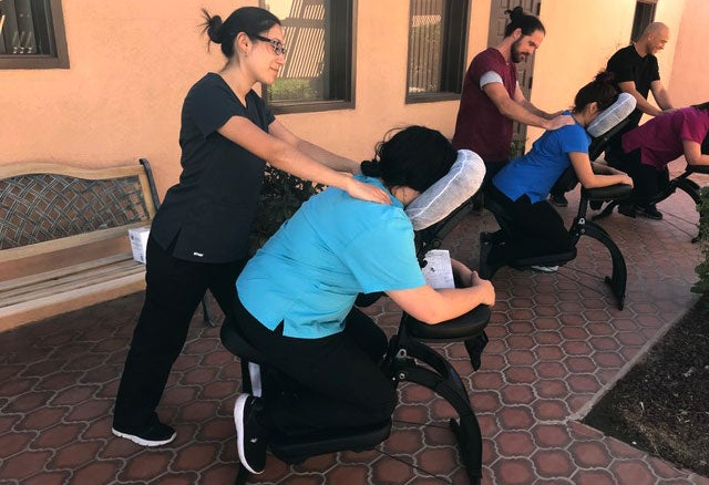 Students receiving a massage