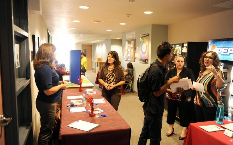 Students visit tables at Experience AWC event