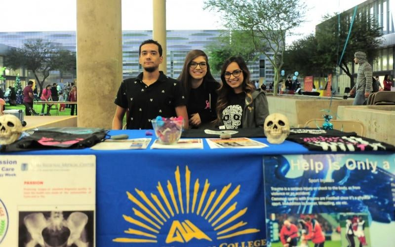 Rad Tech students host a table at a college event