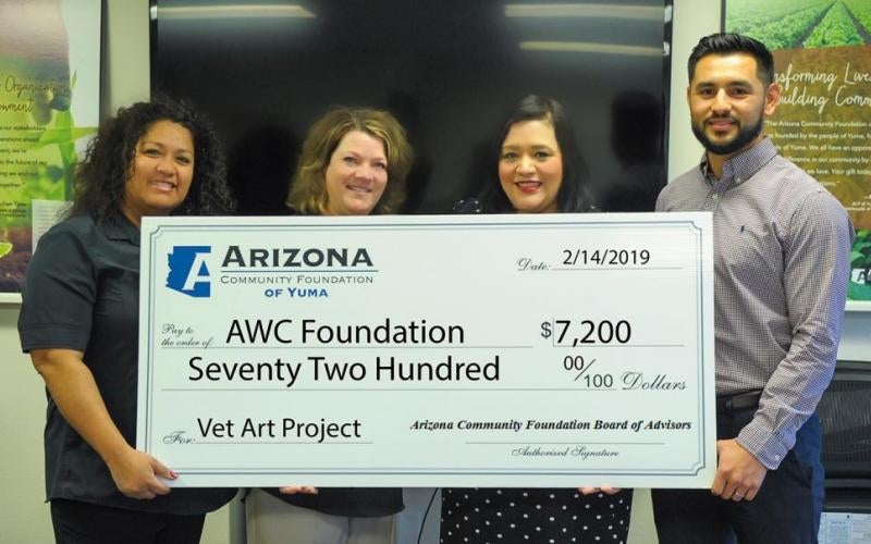 Caption information for attached photo:  The Arizona Community Foundation of Yuma presents a $7,200 grant award to Arizona Western College to continue the Veterans Art Project through December. Pictured left to right: AWC Coordinator of Development and Alumni Relations Gladys Anaya, AWC Director of Institutional Advancement Renee Smith, ACFY Regional Director Veronica Shorr, and ACFY Regional Philanthropic Coordinator Miguel Salcedo. Photo by Alejandro Lastra.
